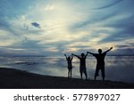 silhouette of young man and his ... | Shutterstock . vector #577897027