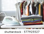 ironing clothes on ironing board | Shutterstock . vector #577925527