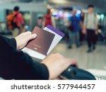 hand holding passport boarding... | Shutterstock . vector #577944457