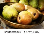 pears in copper tray and basket ... | Shutterstock . vector #577946107