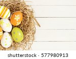 Easter Eggs On The White Woode...
