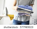 ironing clothes on ironing board | Shutterstock . vector #577985023