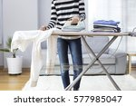 ironing clothes on ironing board | Shutterstock . vector #577985047