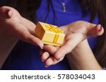 female hands holding a present... | Shutterstock . vector #578034043