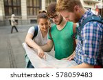 young happy tourists holding... | Shutterstock . vector #578059483