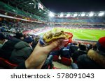 burger in man hand and stands... | Shutterstock . vector #578091043