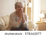 praying elderly woman sitting... | Shutterstock . vector #578162077