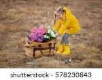 little girl in a yellow... | Shutterstock . vector #578230843