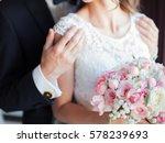 groom holding brides shoulders   Shutterstock . vector #578239693