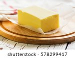 butter block on wooden board.... | Shutterstock . vector #578299417
