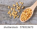 pine nuts on wooden background. ... | Shutterstock . vector #578313673