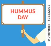 hummus day. hand holding wooden ... | Shutterstock .eps vector #578332033