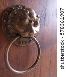Small photo of Old braze lion head knocker decorate on the wooden door. Chinese style door. Space tor text.