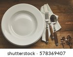 Empty Place Setting With Rosar...