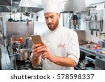 chef cook using smart phone at... | Shutterstock . vector #578598337
