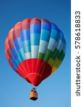 Small photo of Hot air balloon, colorful aerostat on blue sky