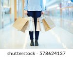 low section of shopper with... | Shutterstock . vector #578624137