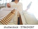 female shopper with striped... | Shutterstock . vector #578624287