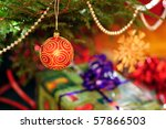 Close up of christmas tree with gifts. - stock photo