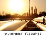 golden steel pipe network in... | Shutterstock . vector #578665453
