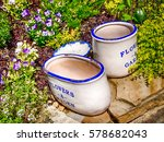 Retro Flower Pots On Stone Wal...