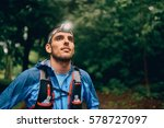 fit male jogger with a headlamp ... | Shutterstock . vector #578727097