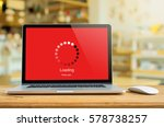 laptop on table with loading... | Shutterstock . vector #578738257