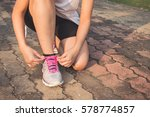 running shoes   woman tying... | Shutterstock . vector #578774857