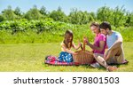 family on picnic at sunny day | Shutterstock . vector #578801503