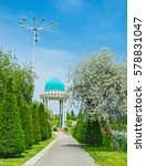 Small photo of The scenic memorial alcove in asian style among the greenery of large garden, Tashkent, Uzbekistan.
