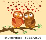 A Pair Of Cute Owlet Sitting O...