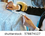 couturier sews a dress in the... | Shutterstock . vector #578874127