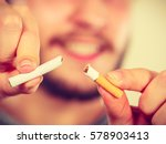 Small photo of Smilling man breake down cigarette. Winning with addicted nicotine problems, stop smoking. Quitting from addiction concept.