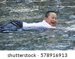 an asian boy playing in the pool | Shutterstock . vector #578916913