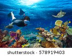 young men snorkeling exploring... | Shutterstock . vector #578919403