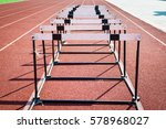 a hurdle race on red running in ... | Shutterstock . vector #578968027