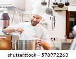 chef cook in uniform cooking... | Shutterstock . vector #578972263