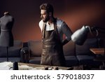 young handsome tailor with... | Shutterstock . vector #579018037