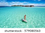 woman on a stand up paddle... | Shutterstock . vector #579080563