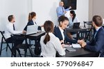 smiling efficient employeesin... | Shutterstock . vector #579096847