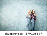 female friends using smart... | Shutterstock . vector #579106597