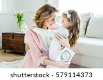 happy mother hugging her... | Shutterstock . vector #579114373