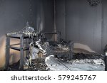 Small photo of chair and furniture in room after burned by fire in burn scene of arson investigation course