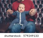 a young father is sitting on a... | Shutterstock . vector #579249133