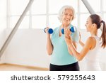 delighted aged woman holding... | Shutterstock . vector #579255643