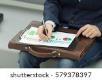businessman with a briefcase is ... | Shutterstock . vector #579378397
