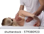 Small photo of Chiropractic, osteopathy, dorsal manipulation. Therapist doing healing treatment on women's back . Alternative medicine, pain relief concept isolated on white.