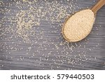 Small photo of Amaranth seeds in wooden spoon (Amaranthus)