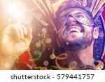 guy wearing carnival costume | Shutterstock . vector #579441757