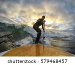 Stock photo surfing the waves at the pacific ocean in tofino vancouver island british columbia bc canada 579468457